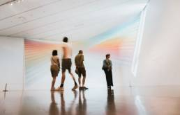 Four museum visitors viewing color installation at the museum of modern art