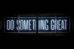 'Do something great' written with white neon lights